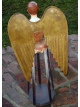 wooden Santos statue with wings