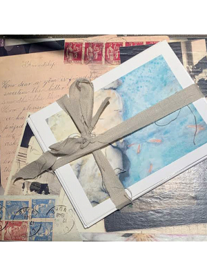 Above The Fray art cards tied in ribbon